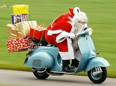 italian santa claus on vespa scooter