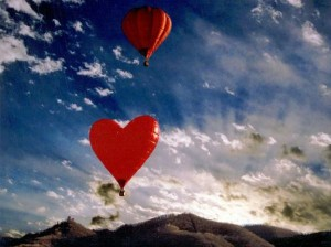 love is in the air -- heart-shaped hot air balloons in the sky