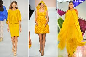 women dressed in yellow