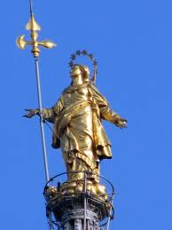 statue of la madonnina on milan's duomo rooftop