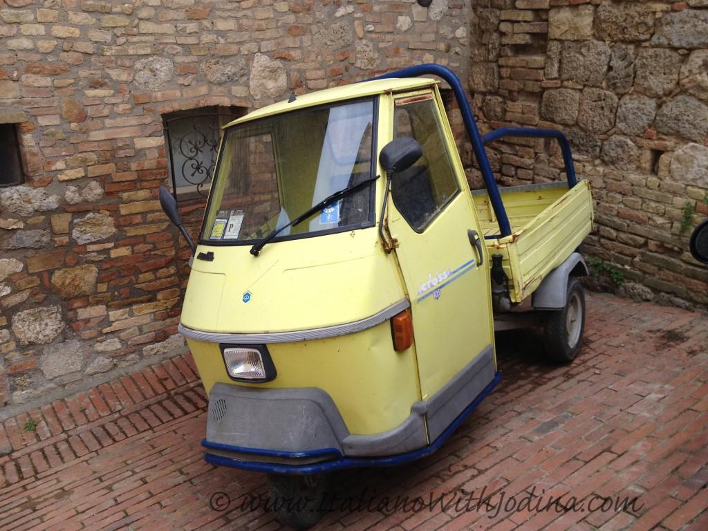 italian 3-wheeler car motocarro ape in san gimignano