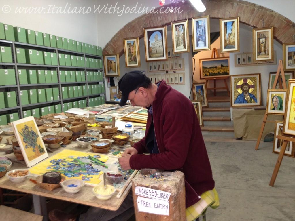 an artisan creates mosaics in montepulciano italy