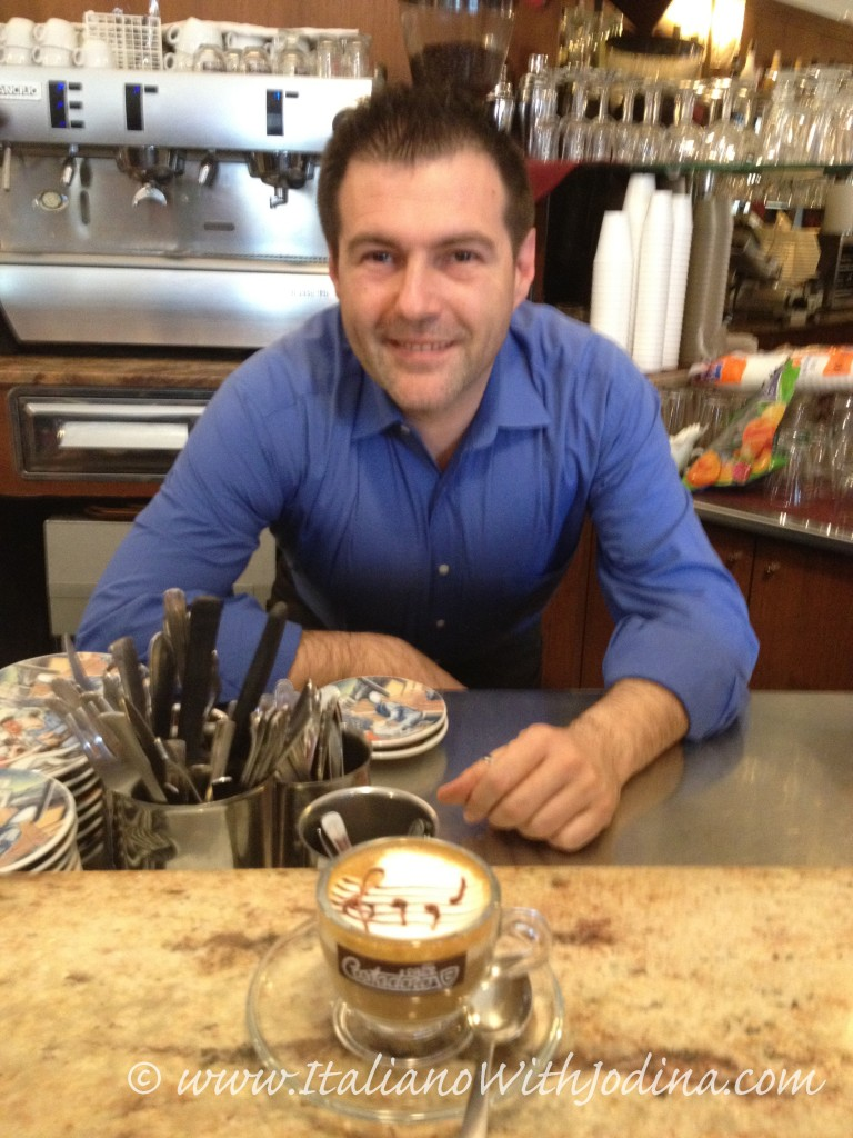 a barrista in Piedmont serves cappuccino