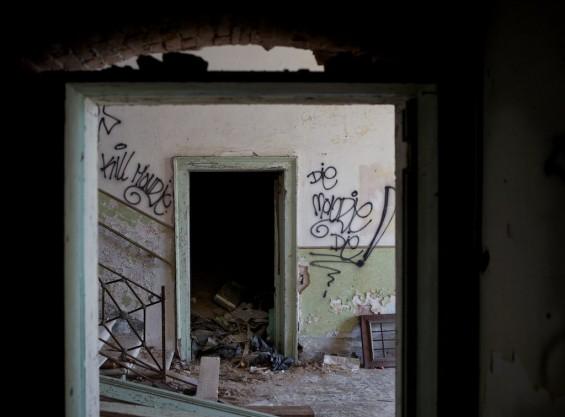 italy haunted poveglia view thru doorway room with graffiti
