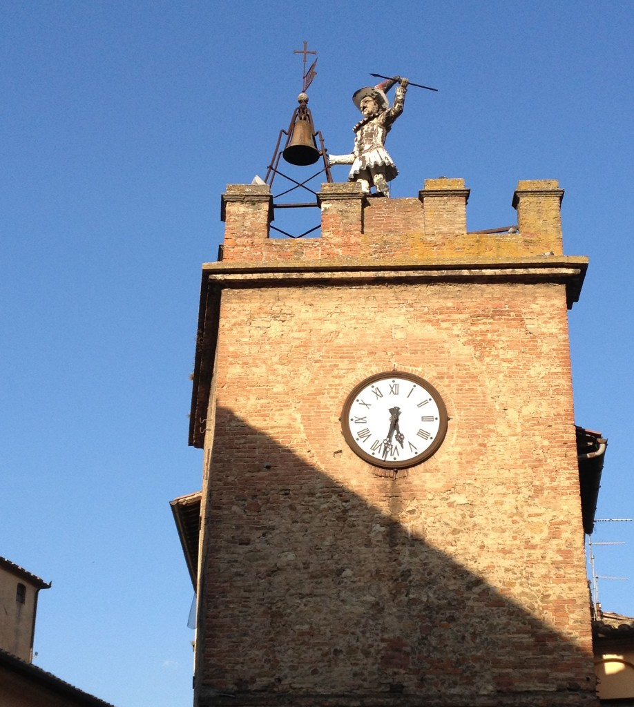 bellringer atop clock tower