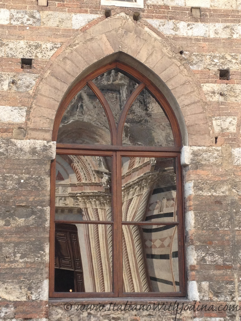 duomo reflected in window