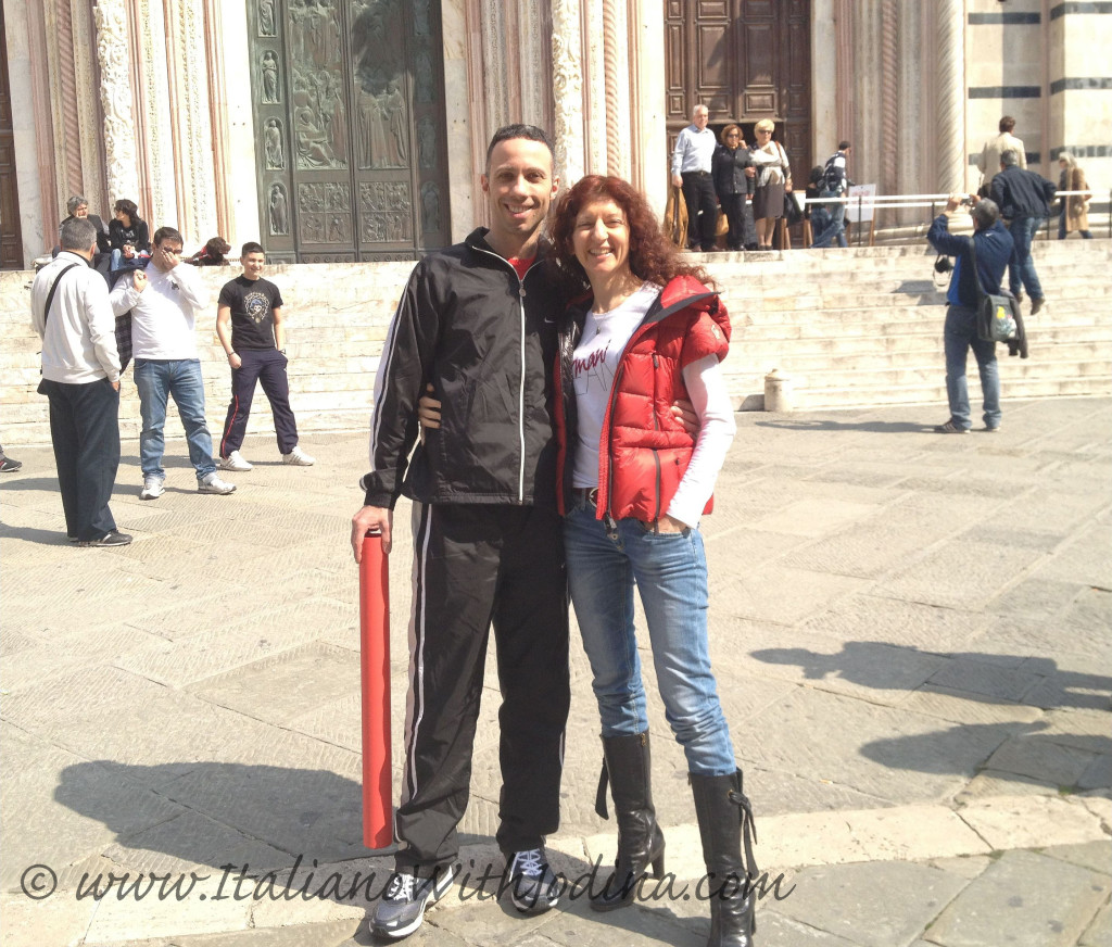 an italian couple poses in piazza duomo