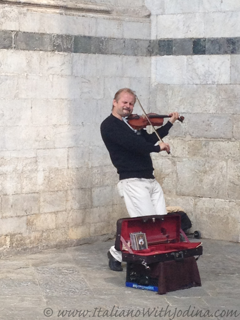 a fiddler in siena italy near piazza del duomo