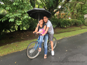 couple on bike with umbrella - wm